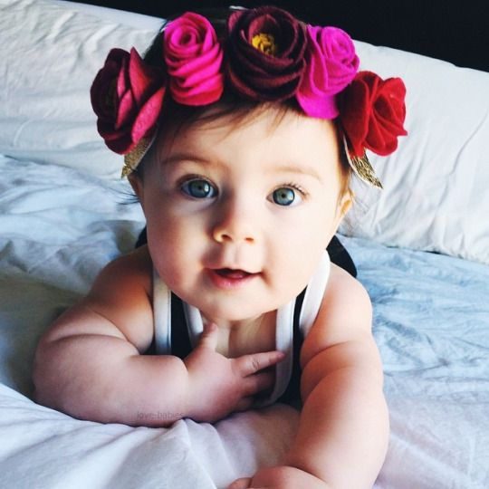 Cute Baby Girl with Rose Flowers
