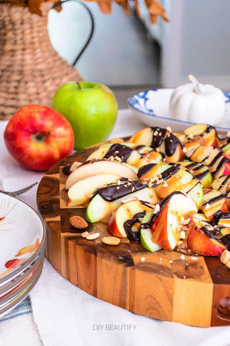 apple nachos with caramel and chocolate drizzle and crushed nuts