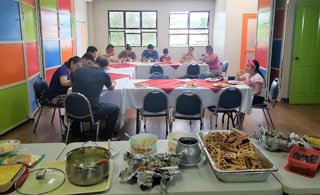 Food and attendees eating.