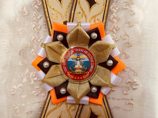 Orange and gold rosette leis for Philippine Coast Guard (PCG)
