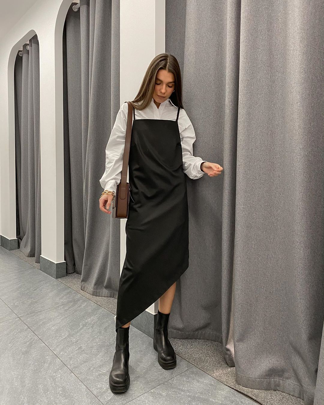 How to Transition a Slip Dress Into Spring — Instagram Outfit: White Button-Down Shirt, Black Silk Dress, and Chunky Black Lug Sole Boots