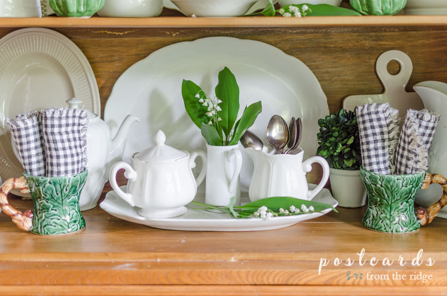 white ironstone and lettuce ware with black and white cloth napkins