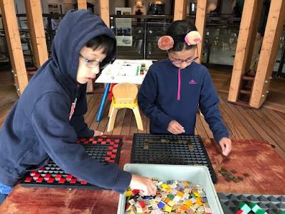 Children doing a mosaic activity at a Roman Villa
