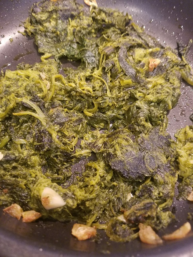 this is a large amount of sauteed broccoli rabe aka Rapini in Italian and how to cook it with garlic and olive oil
