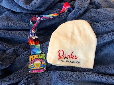 Parks Half Marathon medal and hat