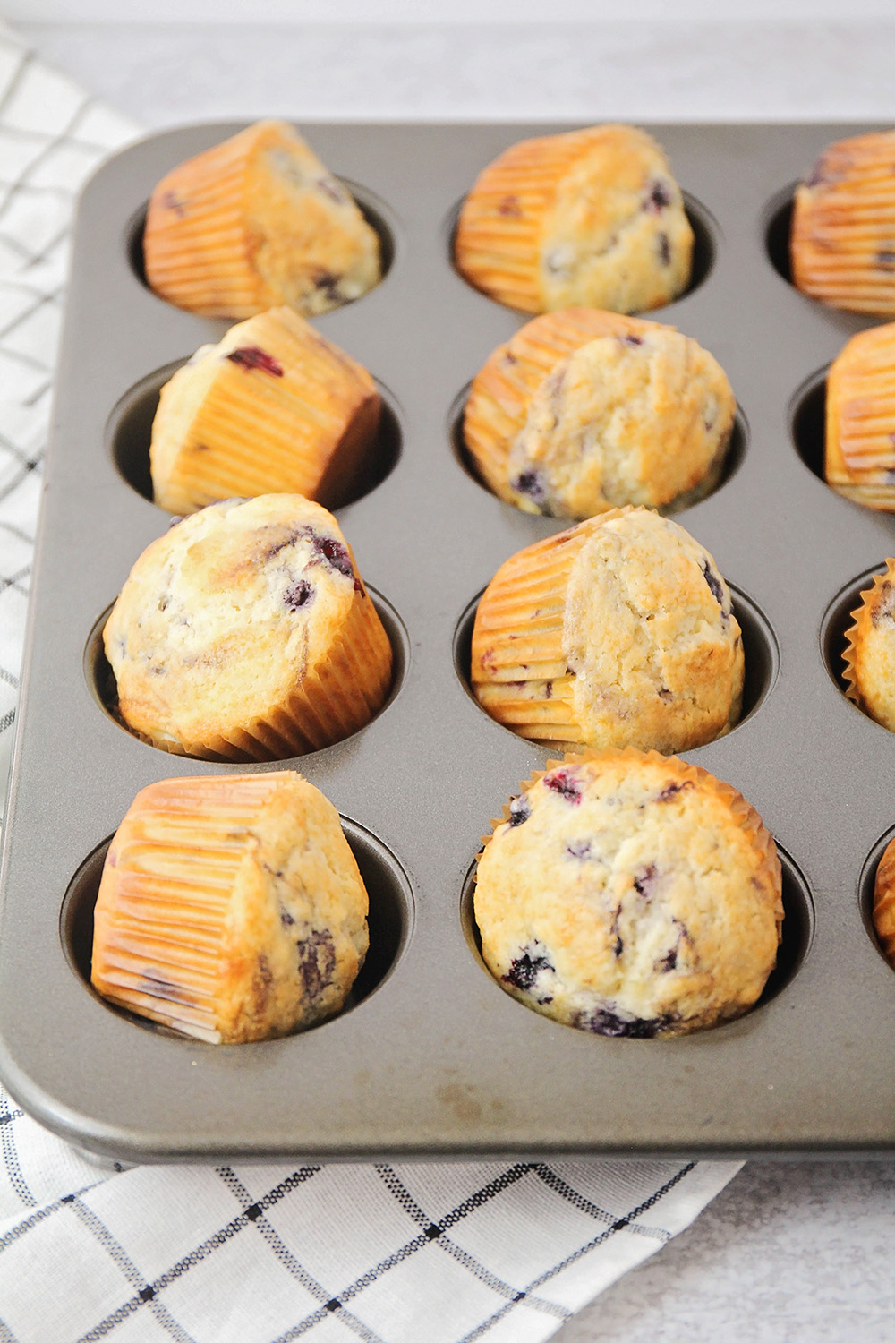 These huckleberry muffins are so light and fluffy, with delicious little huckleberries studded throughout!