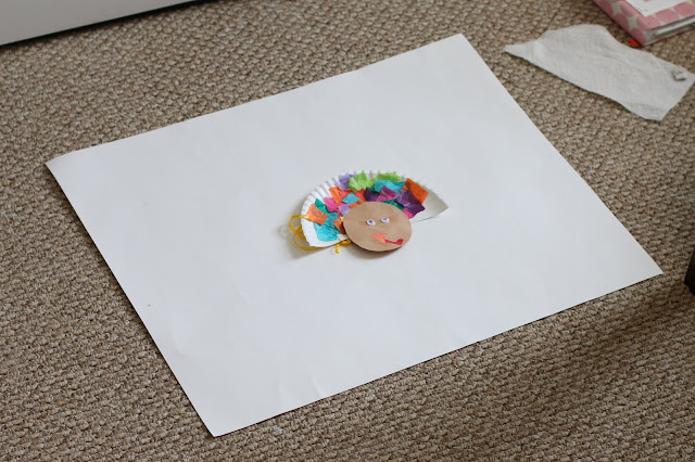 Child's artwork on a white background, prepped for a photo