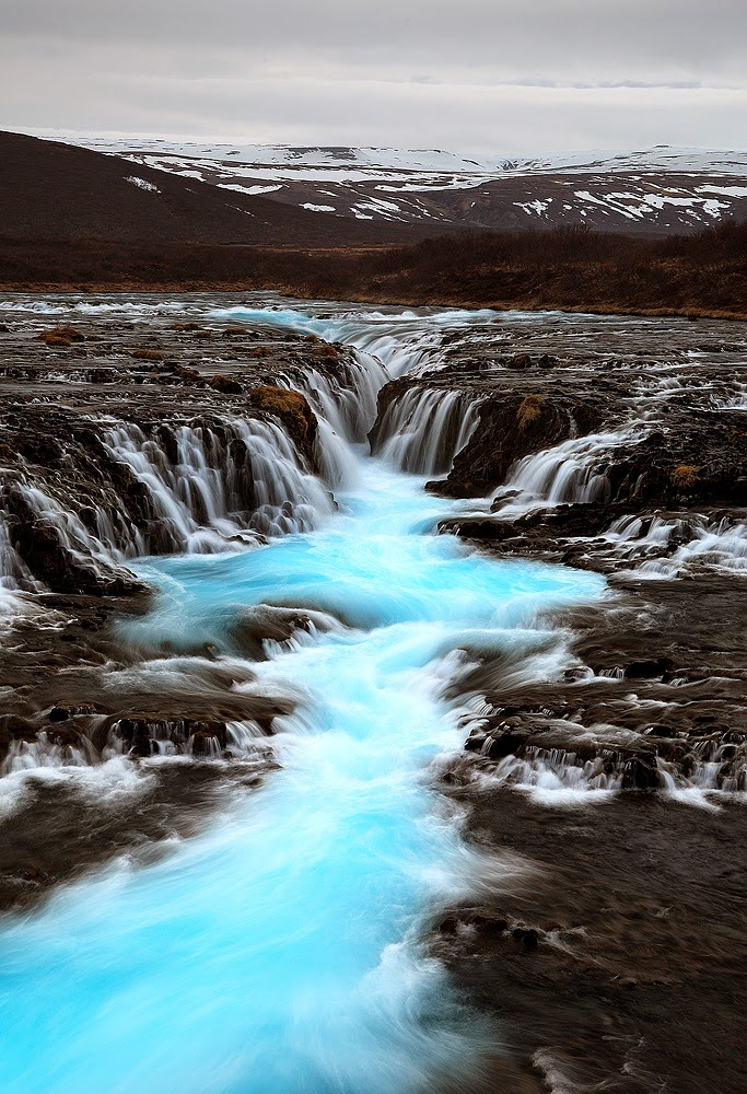 Turquoise river Iceland 10 Most Beautiful Island Countries in the World