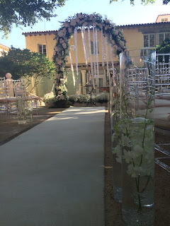 Wedding ceremony aisle decoration with white ranner