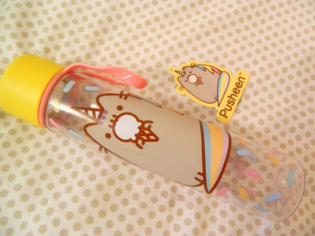 A Pusheen water bottle with a design of ice cream sprinkles and cute Pusheenicorn