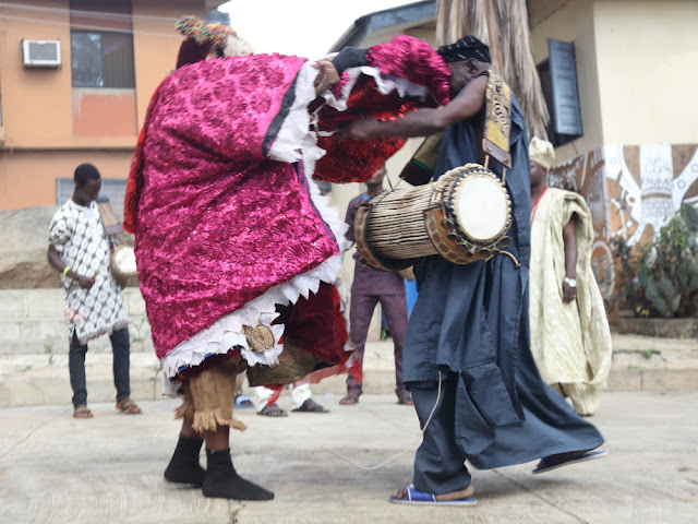 the Egungun interacting with the talking-drum player