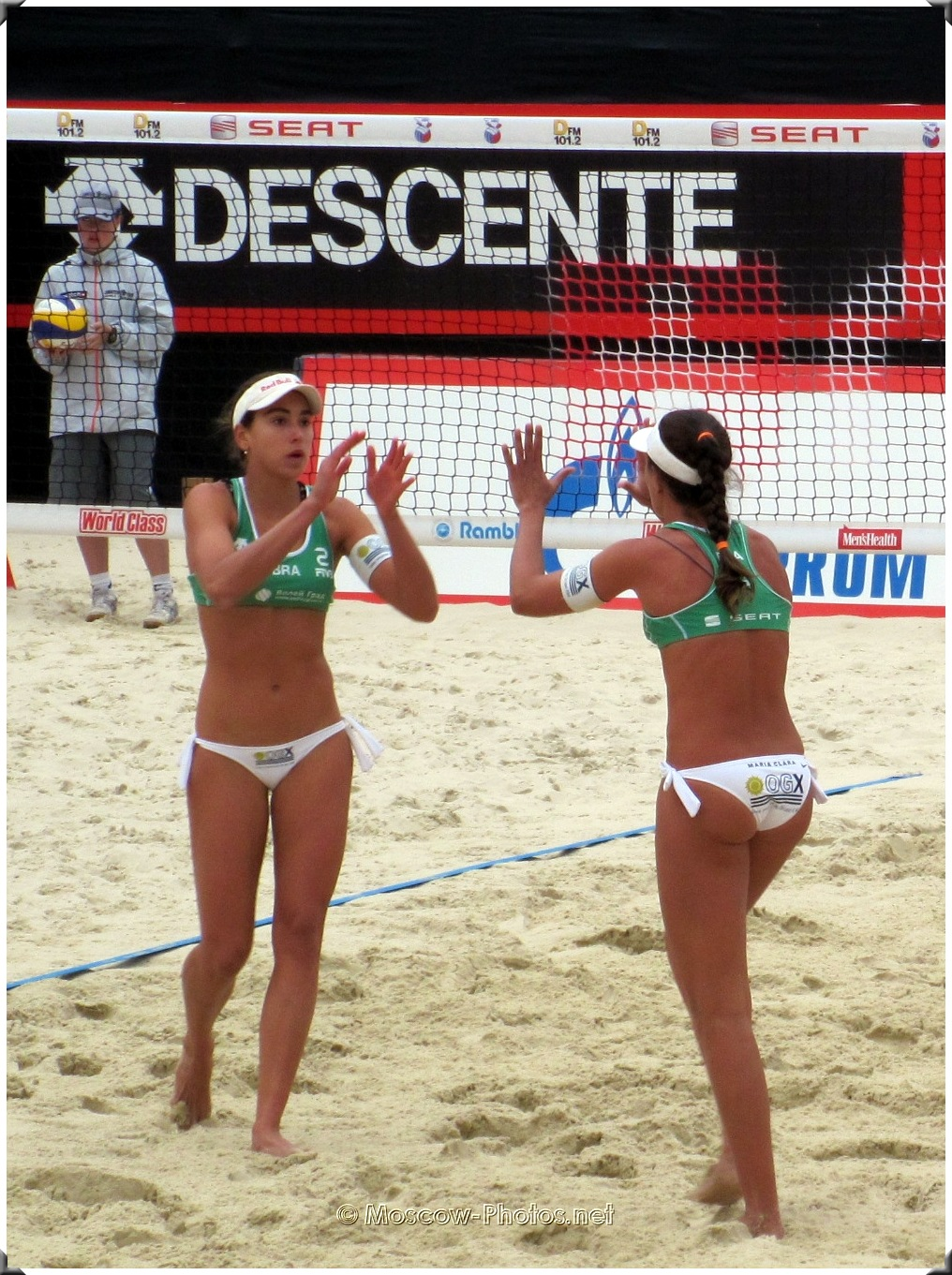 Brazili volleyball players greet each other