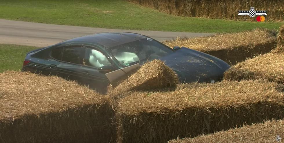 Watch this Alpina B8 Rearrange the Hay Bales at Goodwood's Hairiest Corner
