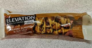 An open package of Elevation Caramel, Almond & Sea Salt Nut Bar, from Aldi