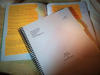 A manuscript, and first notes on bright orange Sticky notes