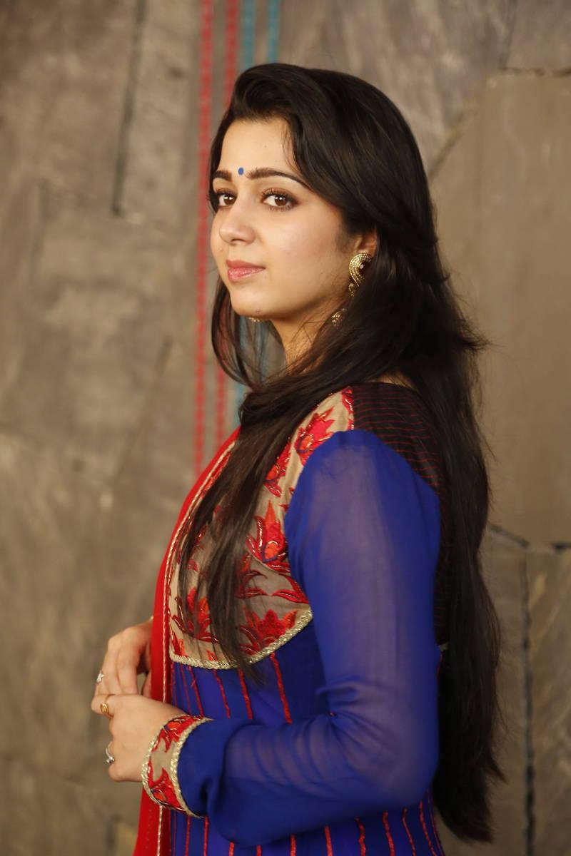 Charmi Kaur Photos in Salwar Kameez at Jyothi Lakshmi ...