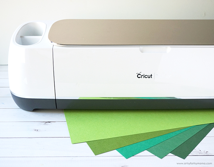 Cricut with variety of green papers