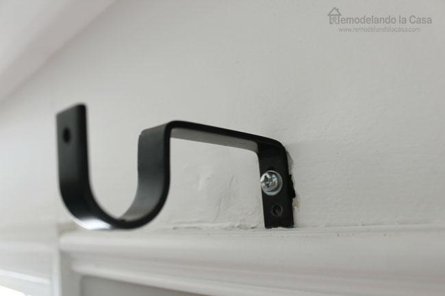 how to repair a curtain rod anchor that