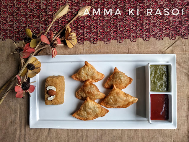 Samosa made with whole wheat with mint chutney and tomato sauce along with Suji Halwa
