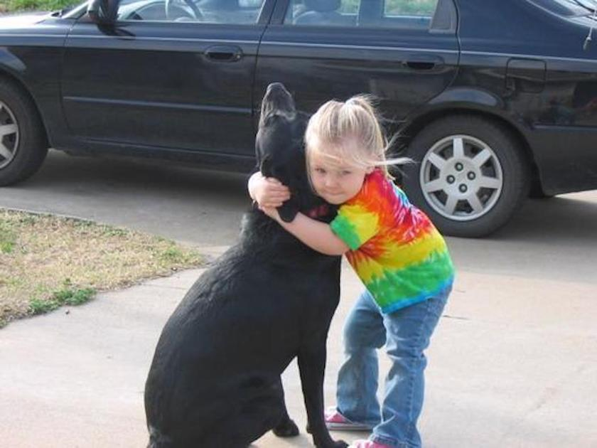 Meredith age 4 hugs her dog Abbey. Mailed the photo to God so he would recognize Abbey. marchmatron.com