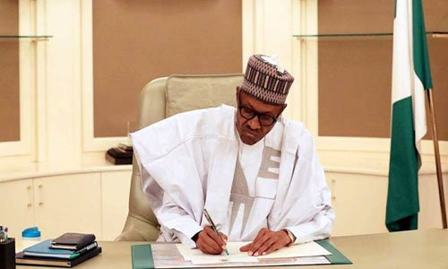 Buhari signs COVID-19 law