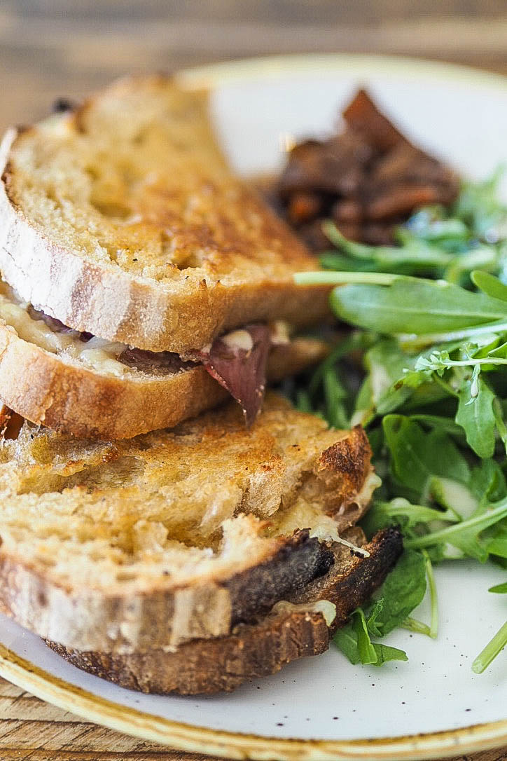Cheese, ham and pickle sandwich with rocket