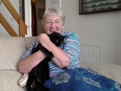 Tiggy being hugged by her new owner Marion