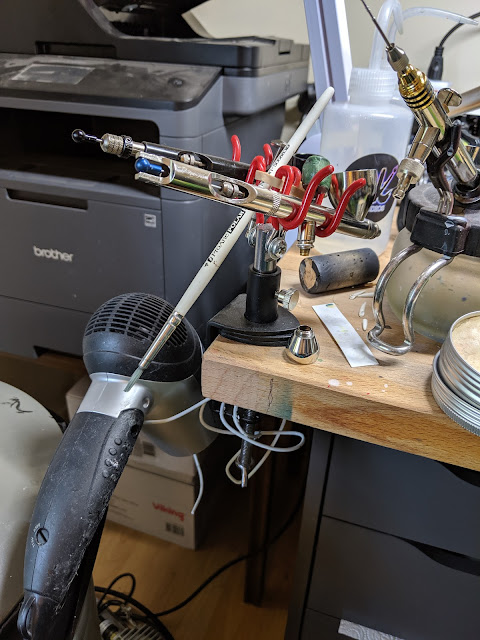 Airbrush stand with bent wire coathanger to form the hairdryer holster