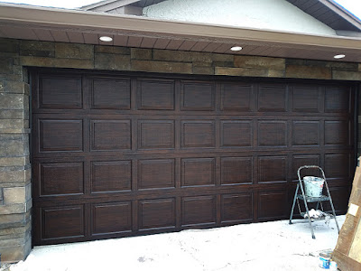 paint a garage door to look like really dark wood
