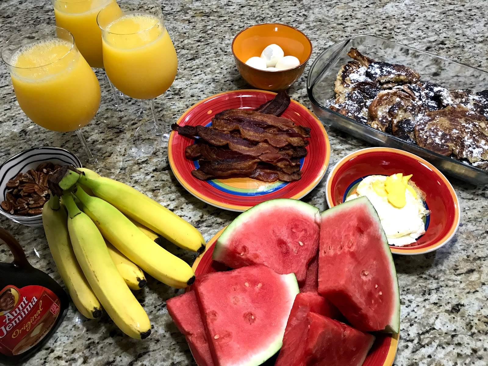 Image: Bananas, watermelon, eggs, bacon, orange juice and french toast. Seen first on bits and babbles blog