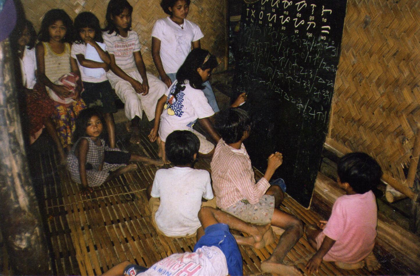 Filipino children writing Baybayin