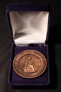 RASC Service Award medal front in case