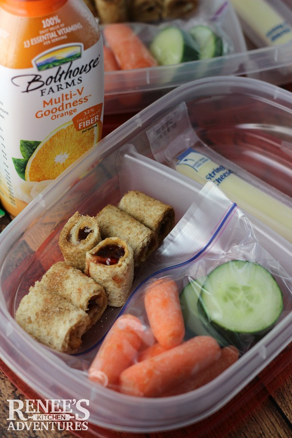 Peanut Butter and Jelly Sushi | by Renee's Kitchen Adventures is an easy recipe for sushi made with peanut butter, jelly and bread. Perfect lunchbox snack or treat. #lunchbox #backtoschool #BackToSchoolSimple #ad
