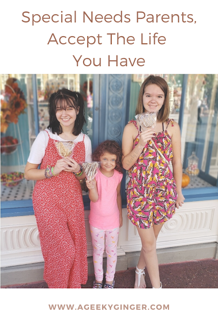Three young girls standing together in front of the Magic Kingdom Confection shop.