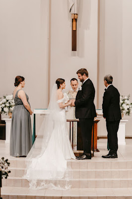 bride and groom at altar holding hands