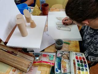 Alumnos dibujando del natural y pintando en acuarelas