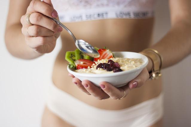 Woman Eating Healthy Snack Yogurt and Fruit