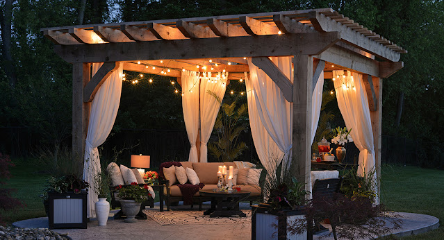 A pergola lit with string lights.