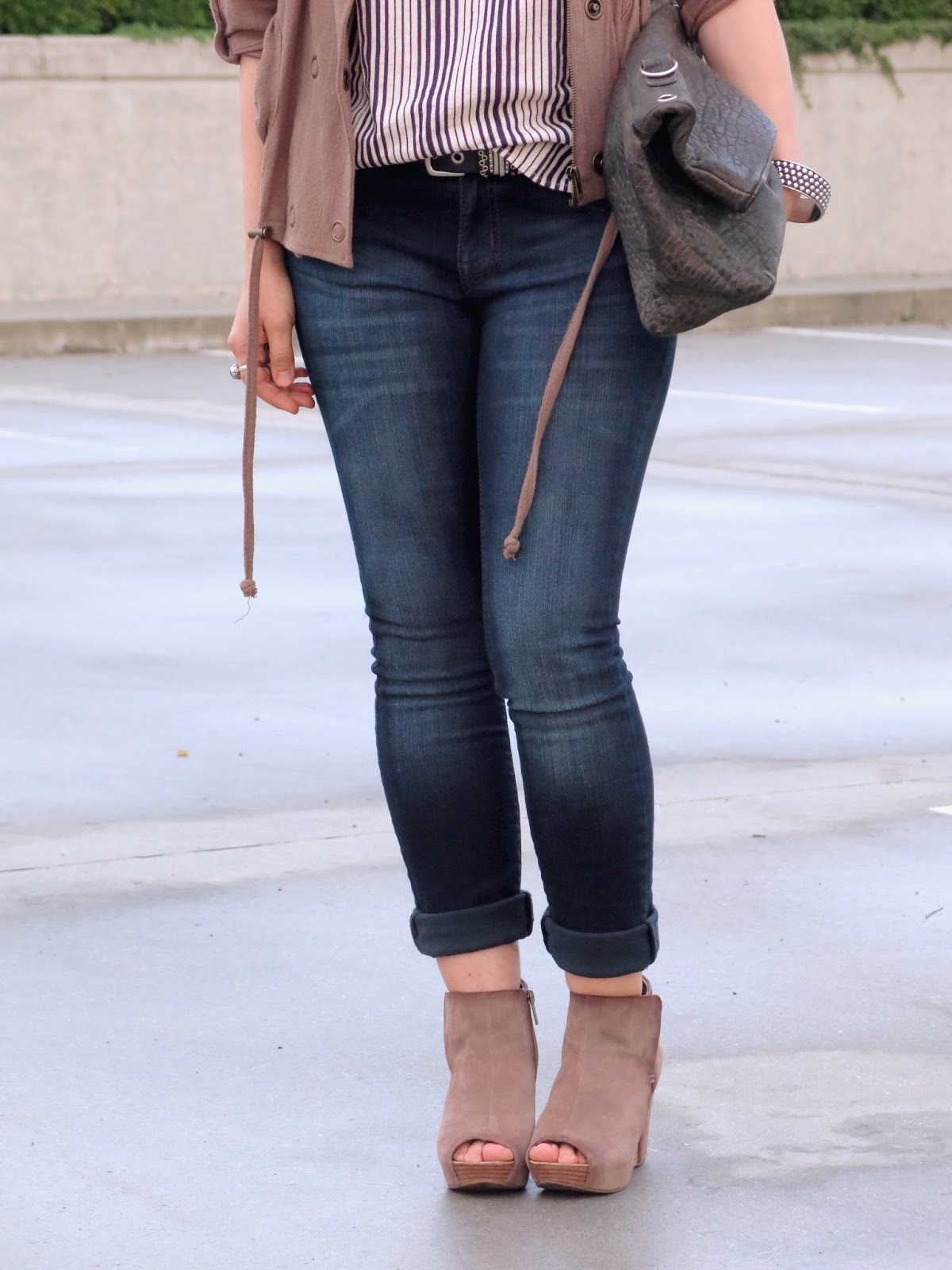 striped tank, khaki bomber jacket, and accessories