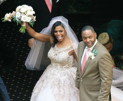 John Allen Newman with his wife Omarosa in their wedding dress