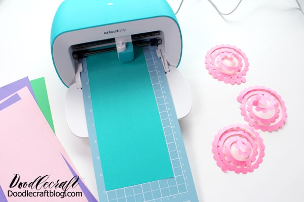 cutting rolled paper flowers on the Cricut joy