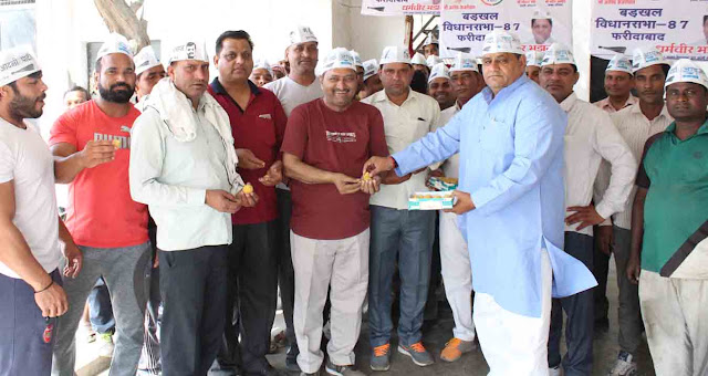 The leader of the Aam Aadmi Party's Hissar rally, the leader Dharmabhir Bhadana shared Laddu