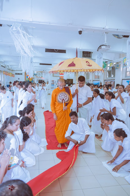 Venerable Thalapath Kande Siri Nanda Thero proceeding to the Dhamma Sermon