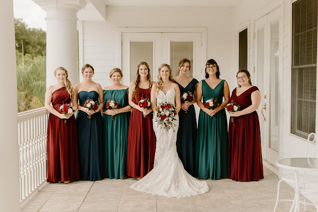 bride and bridesmaids in dark fall colored dresses