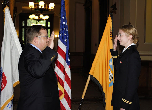 Elise's dad swearing her in as a 2nd Lt. at her commissioning ceremony in 2017.