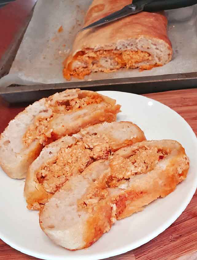 this is pizza roll stuffed with buffalo chicken sliced