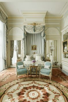 Blue and pastel canopy bed in guest suite at Ritz Paris