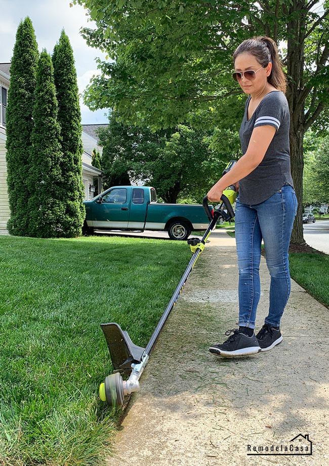 Ryobi lawn care - Cristina Garay trimming the lawn