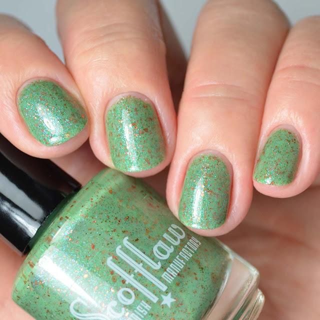 green nail polish with shimmer four finger swatch