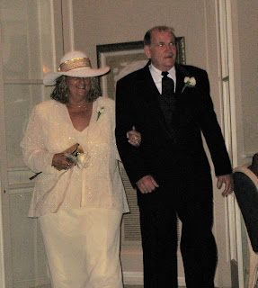 A photo of Paula and Tod Eaton dressed up and entering a room.